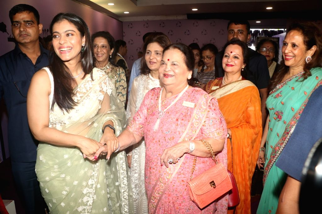 Actress Kajol with Reliance Industries Chairman Mukesh Ambani's mother Kokilaben Ambani at IMC Ladies' Wing - Women Entrepreneurs' Exhibition 2019, in Mumbai on Aug 21, 2019. - Kajol, Mukesh Ambani and Kokilaben Ambani