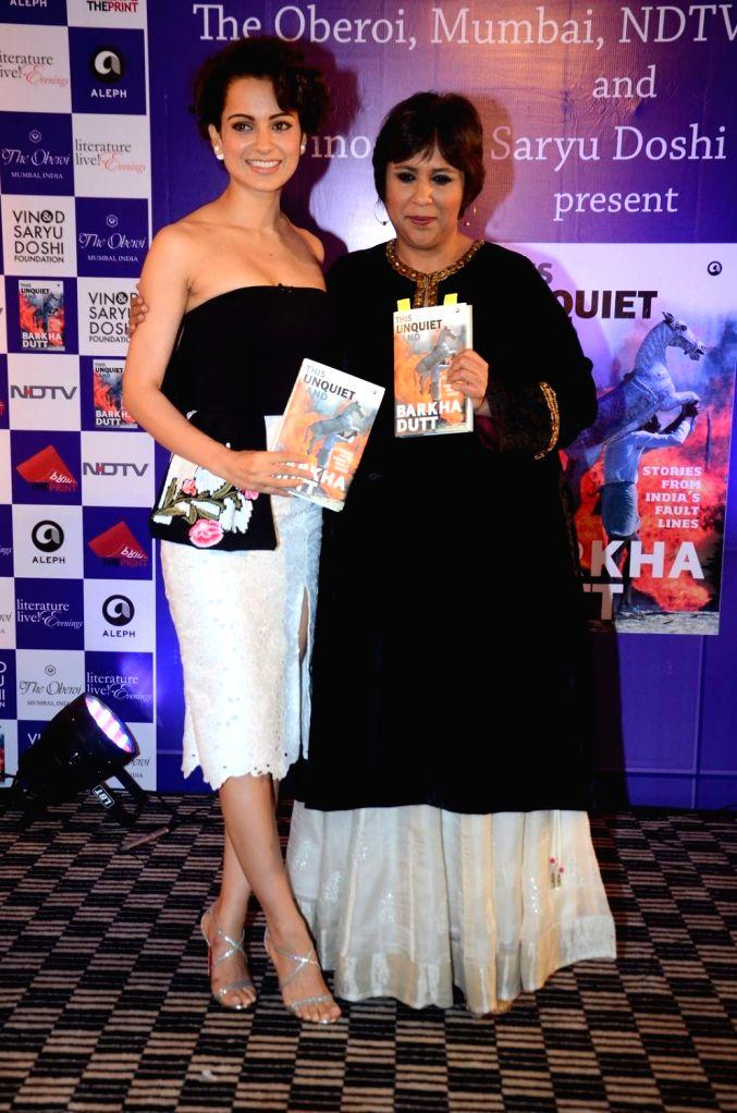 Actress Kangana Ranaut and journalist Barkha Dutt during the launch of Barkha Dutt`s book, This Unquiet Land, on Jan 14, 2016. - Kangana Ranaut