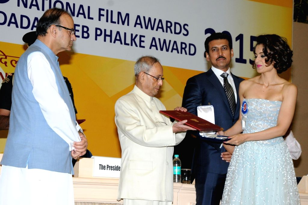 Actress Kangana Ranaut receives best actress award from President Pranab Mukherjee during the 63rd National Film Awards ceremony at Vigyan Bhawan  in New Delhi, on May 3, 2016. - Kangana Ranaut and Pranab Mukherjee