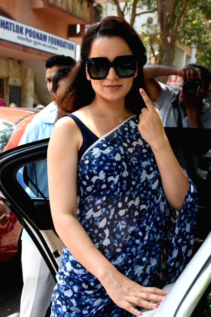 Actress Kangana Ranaut shows her forefinger marked with indelible ink after casting vote during the fourth phase of 2019 Lok Sabha elections in Mumbai on April 29, 2019. - Kangana Ranaut
