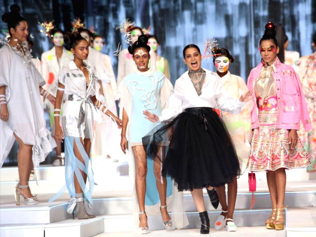 Actress Kangana Ranaut walks the ramp Grand finale of Make-up India Fashion Week, in New Delhi on Oct 12, 2019. - Kangana Ranaut