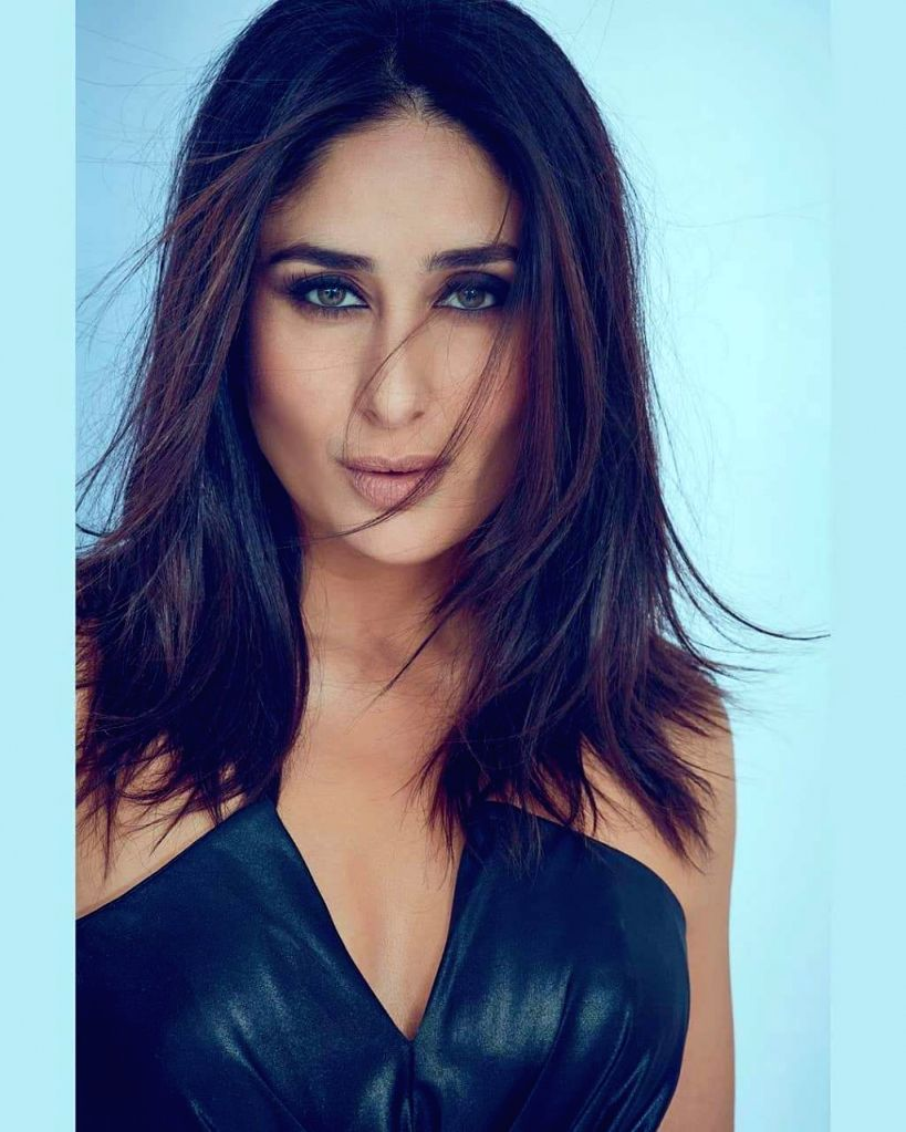 """Actress Kareena Kapoor on Wednesday got all eyes on her hot look. For her dance reality show """"Dance India Dance"""", Kareena looked smoking hot in a smokey eye make-up and a dark blue off-shoulder dress with a green drape tied around her waist. She post - Kareena Kapoor"""