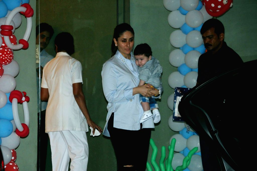 Actress Kareena Kapoor with her son Taimur Ali Khan during Tussar Kapoor son Laksshay`s first birthday party in Mumbai on June 1, 2017. - Kareena Kapoor, Taimur Ali Khan and Tussar Kapoor