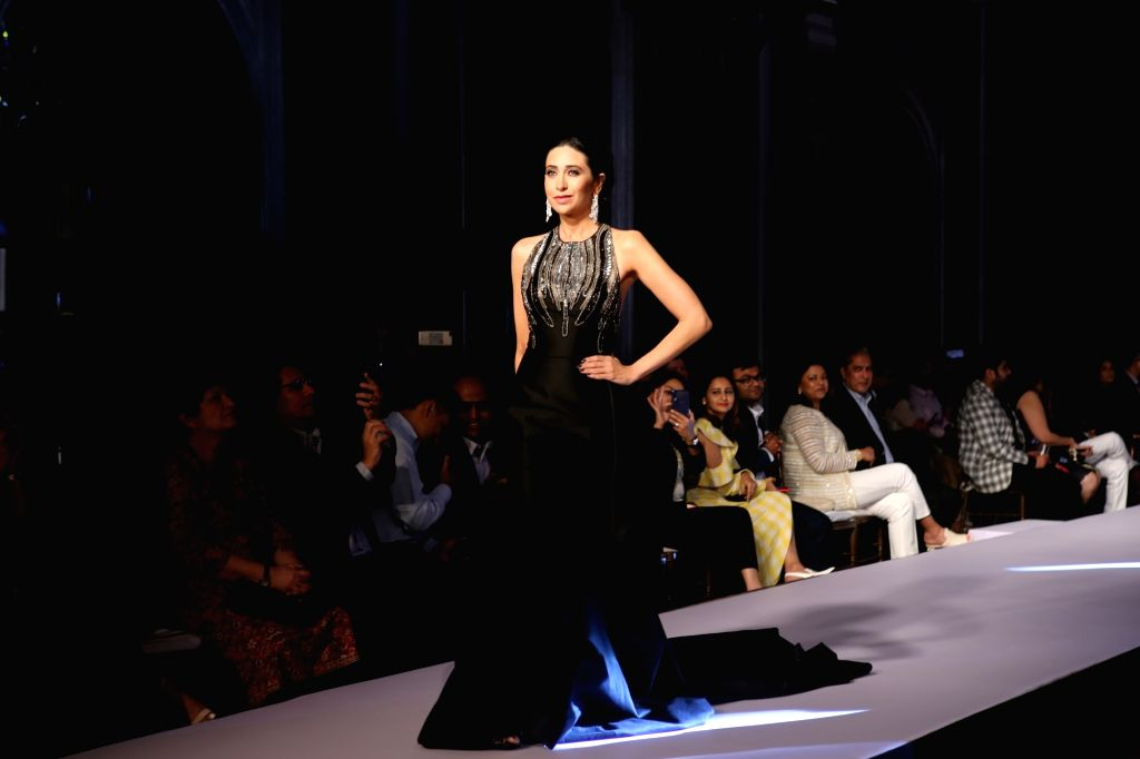 Actress Karishma Kapoor walks the ramp during Forevermark's Red Carpet collection show in Mumbai, on March 6, 2019. - Karishma Kapoor