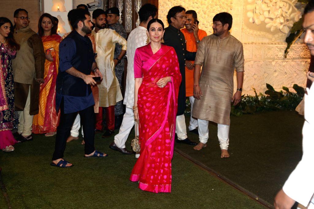 Actress Karisma Kapoor at the Ganesh Chaturthi celebrations organised at Reliance Industries Ltd. Chairman Mukesh Ambani's residence in Mumbai on Sep 2, 2019. - Karisma Kapoor and Mukesh Ambani