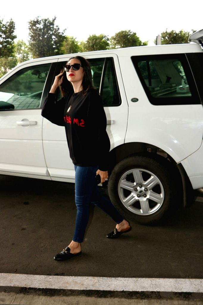 Actress Karisma Kapoor spotted at Chhatrapati Shivaji Maharaj International airport in Mumbai on Aug 4, 2017. - Karisma Kapoor