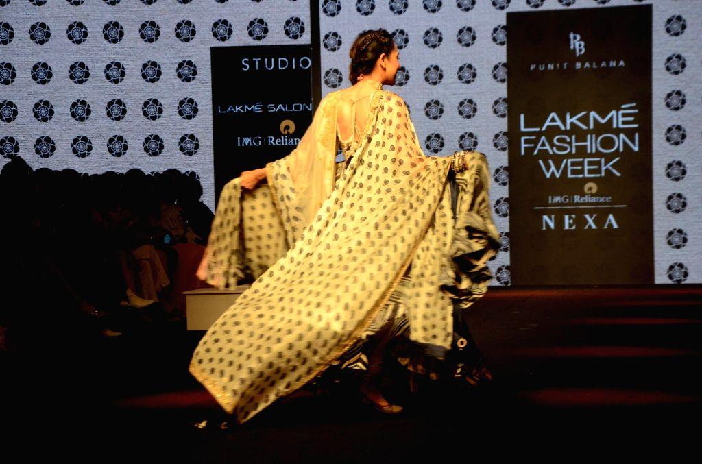 Actress Karisma Kapoor walks the ramp showcasing creations of fashion designer Punit Balana at the Lakme Fashion Week (LFW) Summer/Resort 2019 in Mumbai on Feb 3, 2019. - Karisma Kapoor