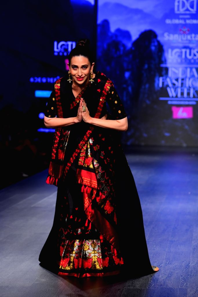 Actress Karisma Kapoor walks the ramp showcasing fashion designer Sanjukta Dutta's creation on the second day of Lotus India Fashion Week in New Delhi, on March 14, 2019. - Karisma Kapoor