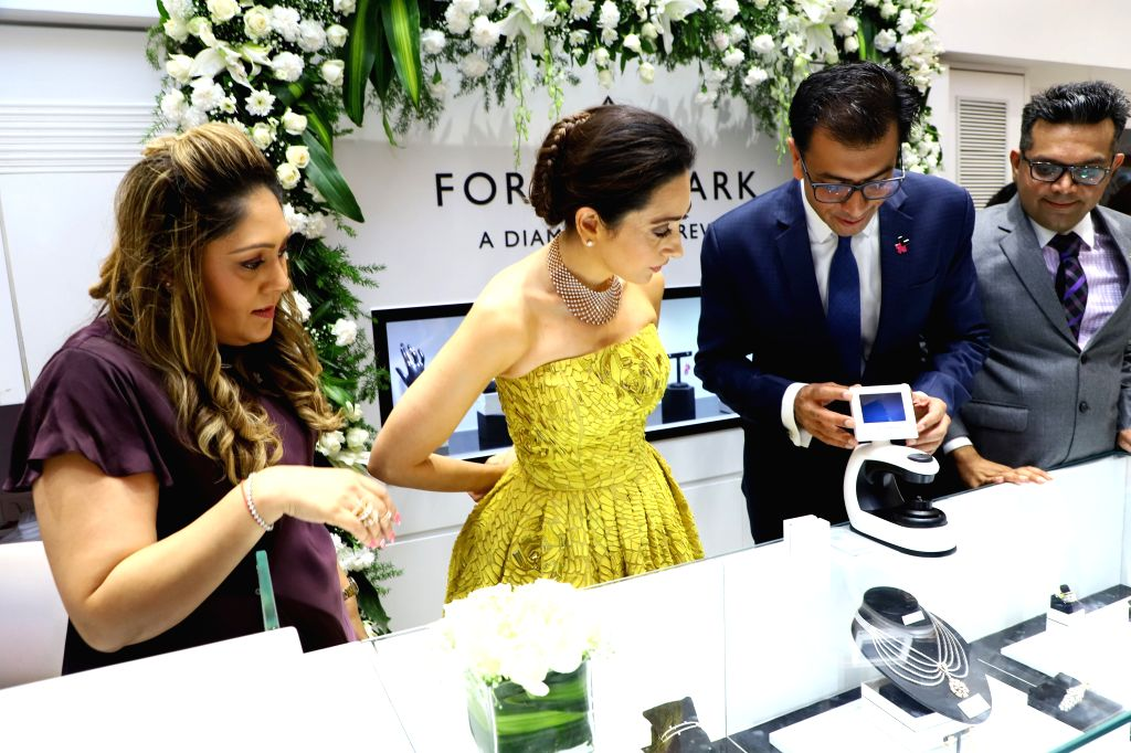 Actress Karisma Kapoor with Forevermark India?President?Sachin Jain and OM Jewellers?Director?Bhavin Jakhia?during the launch of Forevermark's festive collection at OM Jewellers in Mumbai, on ... - Karisma Kapoor and Sachin Jain