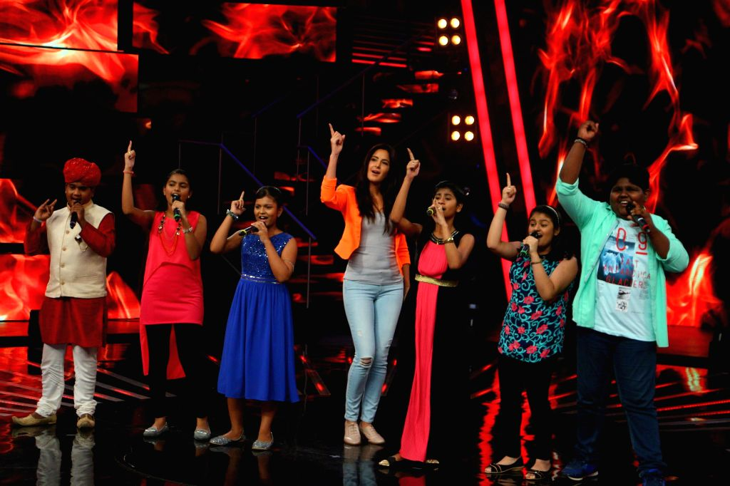 Actress Katrina Kaif with the contestant of ``Indian Idol Junior`` during the promotion of their upcoming film `Phantom` on the sets of ``Indian Idol Junior`` in Mumbai. on Aug 17, 2015. - Katrina Kaif