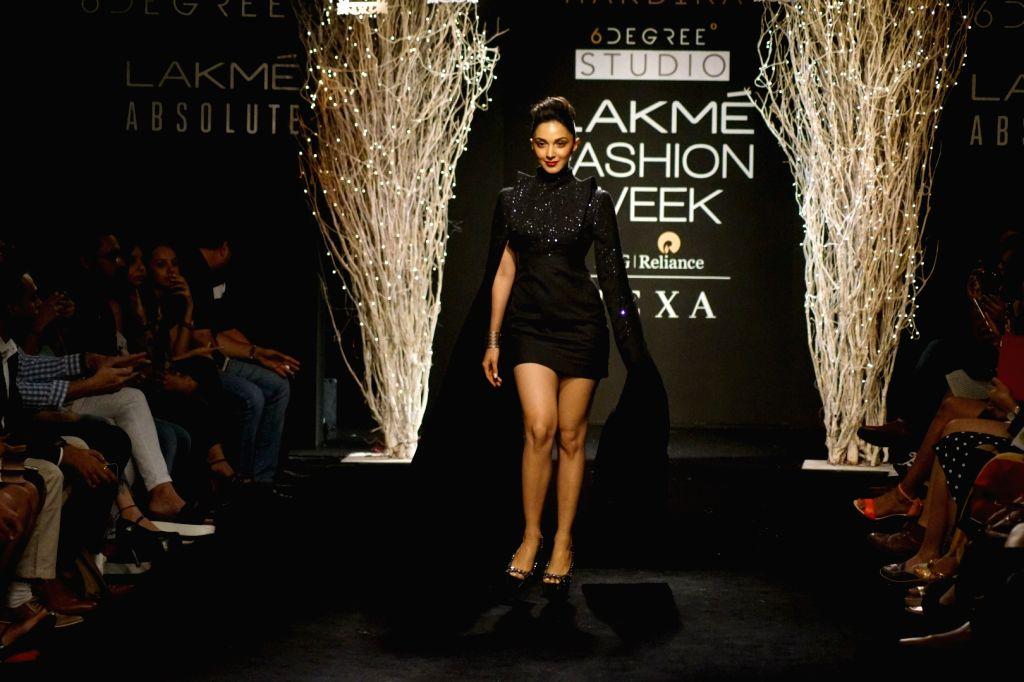 Actress Kiara Advani displays the creation of fashion designer Hardika Gulati during the Lakme Fashion Week Winter/Festive 2017 in Mumbai on Aug 20, 2017. - Kiara Advani