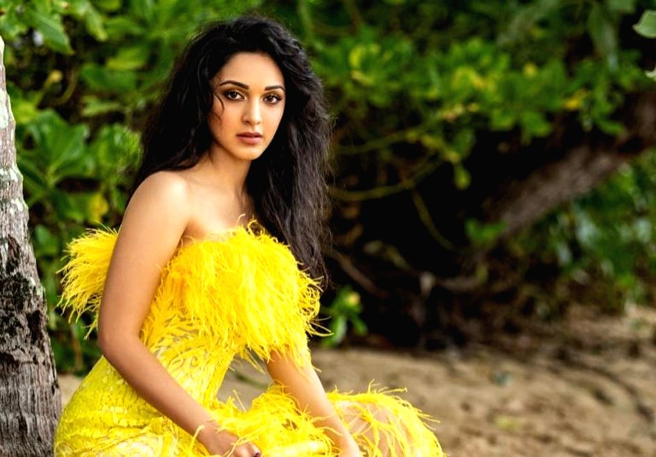 """Actress Kiara Advani has been trolled over her latest photograph, where she is seen flaunting a bright yellow dress. The """"Kabir Singh"""" actress has posted a photo on Instagram where she flaunts an off-shoulder yellow feathery long dress. Fans did not  - Kiara Advani and Kabir Singh"""