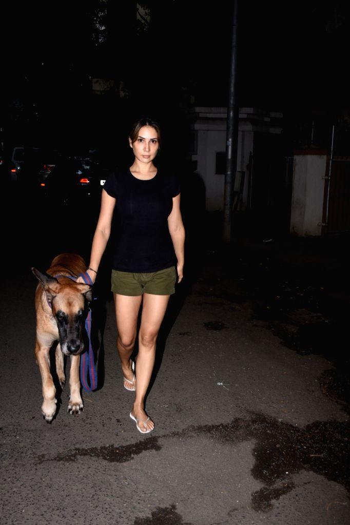 Actress Kim Sharma seen at Bandra in Mumbai on Aug 25, 2019. - Kim Sharma