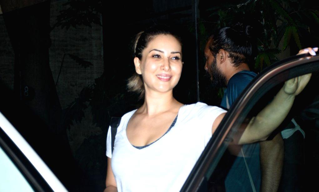 Actress Kim Sharma seen at Bandra, in Mumbai on March 18, 2020. - Kim Sharma