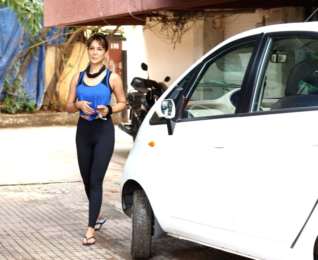 Actress Kim Sharma seen outside a gym at Bandra, in Mumbai, on June 13, 2019. - Kim Sharma