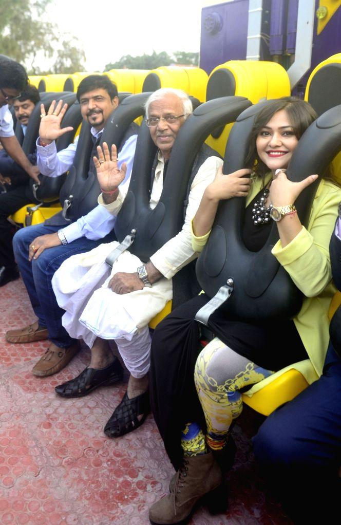 "Actress Koneenica Banerjee, West Bengal Power Minister Sovandeb Chattopadhyay with others during launch of ""Sky Diver Ride"" at NICCO Park in Kolkata on Nov 30, 2016. - Koneenica Banerjee"