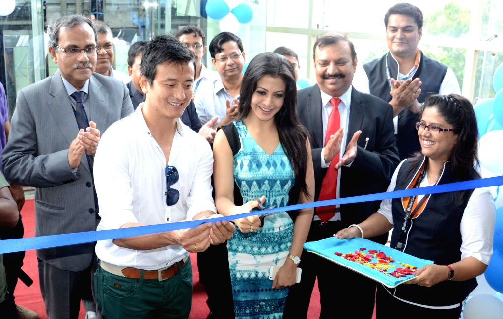 Actress Koyal Mullick with footballer Bhaichung Bhutia and officials launched a new branch of State Bank of India in Kolkata on August 2, 2014.