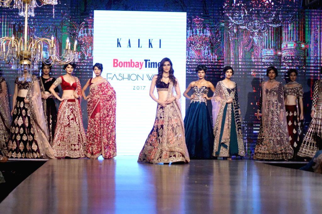 "Actress Kriti Sanon displays the creation of Mirabella Annual Wedding Collection during the ""Bombay Times Fashion Week"" 2017 in Mumbai on Sept 10, 2017. - Kriti Sanon"