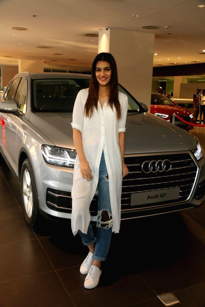 Actress Kriti Sanon poses with her new Audi Q7 in Mumbai on Jan 25, 2018. - Kriti Sanon