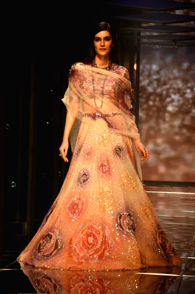 Actress Kriti Sanon walk the ramp for fashion designer Tarun Tahiliani during the Lakme Fashion Week Summer/Resort 2018 in Mumbai on Feb 2, 2018. - Kriti Sanon
