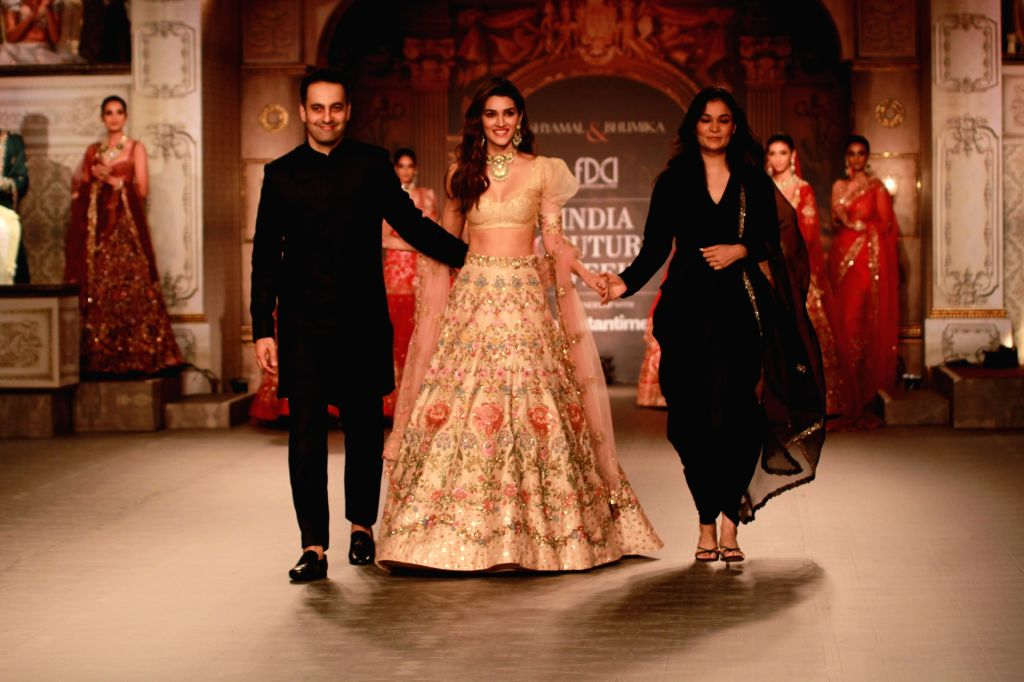 Actress Kriti Sanon walks the ramp for designer duo Shyamal and Bhumika at India Couture Week 2019 in New Delhi, on July 25, 2019. - Kriti Sanon