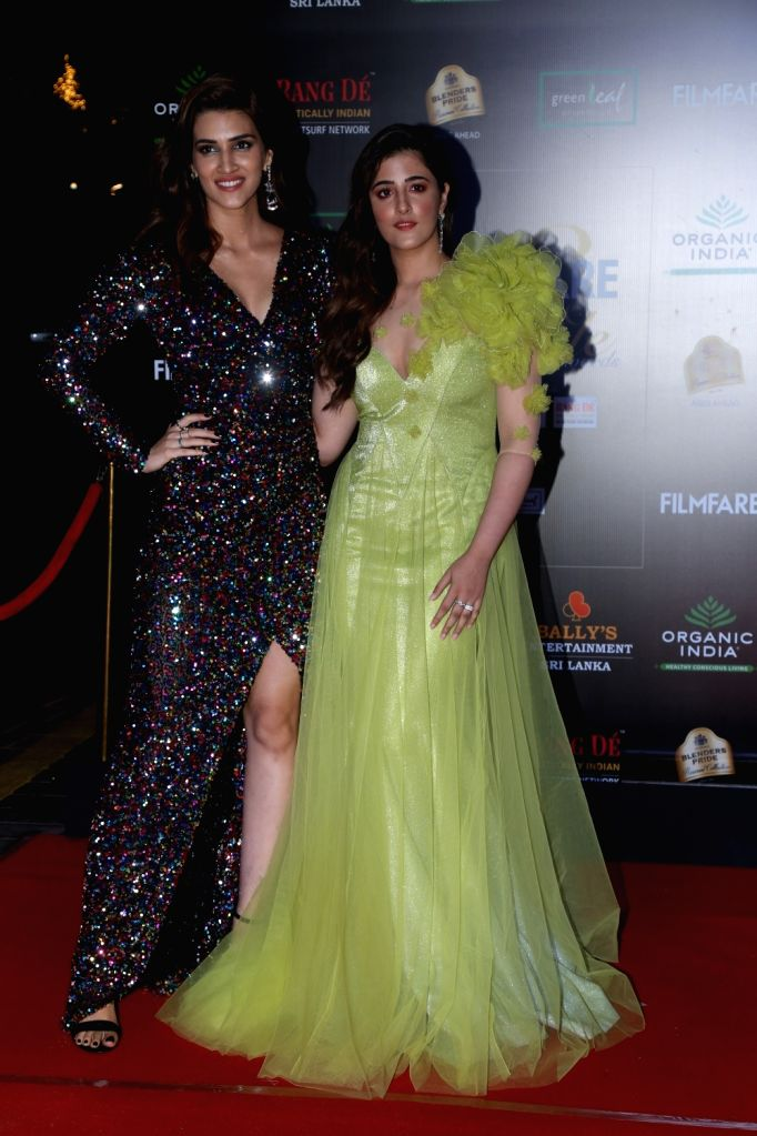 Actress Kriti Sanon with her sister Nupur Sanon on the red carpet of Filmfare Glamour And Style Awards 2019 in Mumbai on Dec 3, 2019. - Kriti Sanon