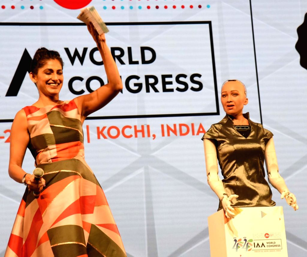 Actress Kubbra Sait and Sophia Robot during the 44th Global Summit of the International Advertising Association (IAA) in Kochi, Kerala on Feb 22, 2019. - Kubbra Sait
