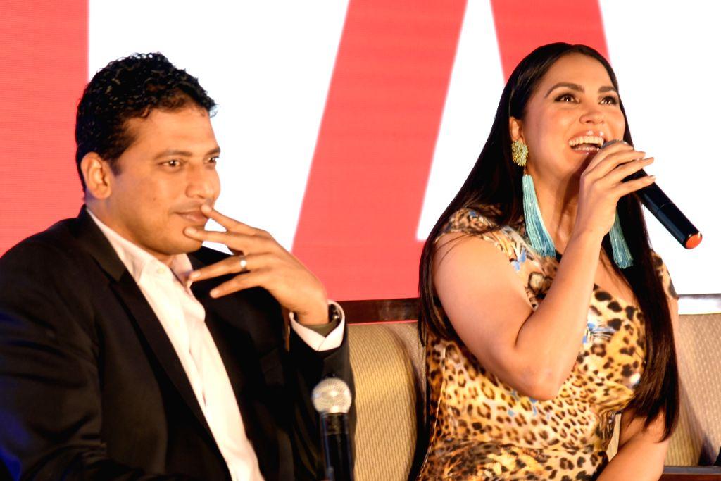 Actress Lara Dutta accompanied by husband and former tennis player Mahesh Bhupati, addresses at a press conference in Bengaluru, on Dec 5, 2018. - Lara Dutta