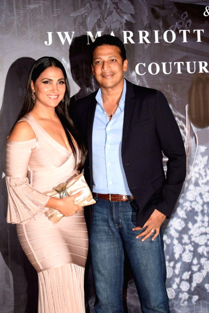 Actress Lara Dutta with her husband and former tennis player Mahesh Bhupathi at the red carpet of fashion designer Manish Malhotra's haute couture show, in Mumbai on Aug 1, 2018. - Lara Dutta, Mahesh Bhupathi and Manish Malhotra