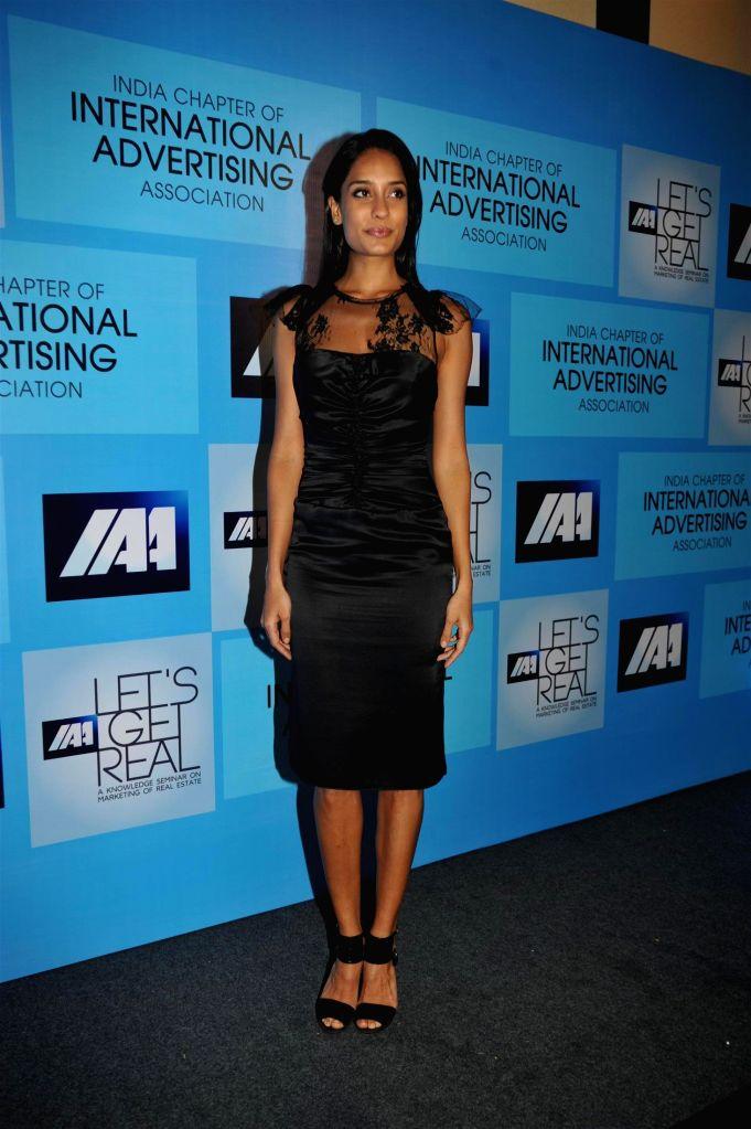 Actress Lisa Haydon attends the International Advertising Association's knowledge seminar on marketing of real estate in Mumbai on Oct. 9, 2014.