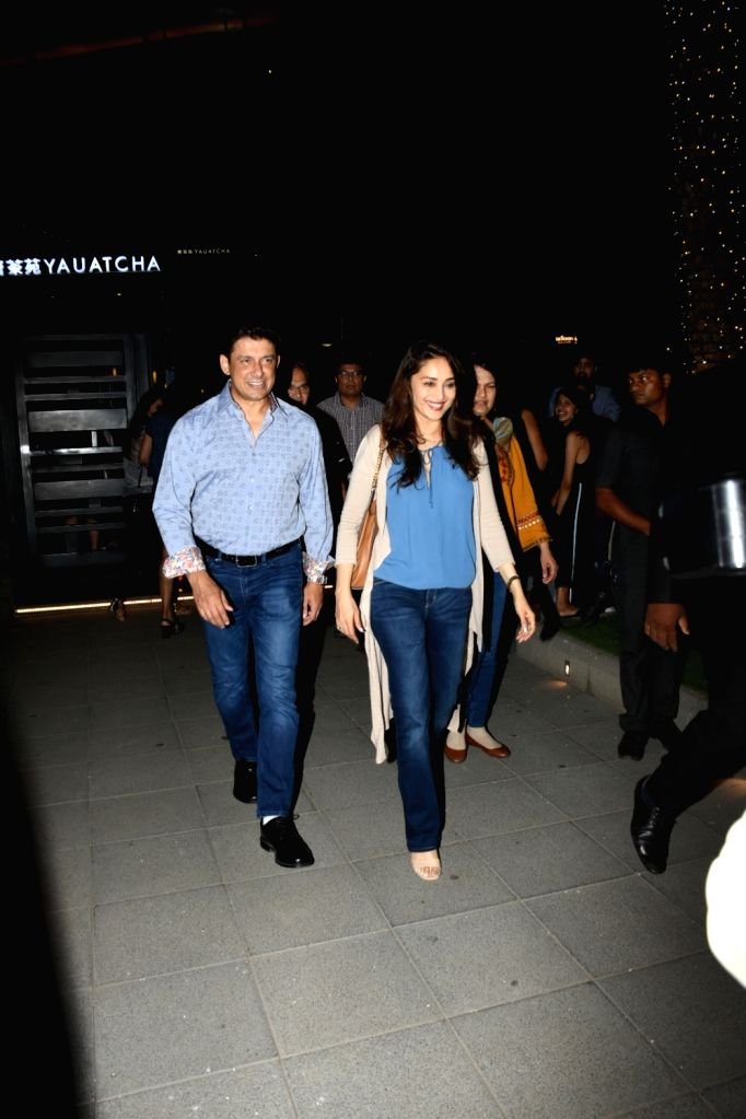 Actress Madhuri Dixit along with her husband Sriram Madhav Nene seen in Mumbai's Bandra Kurla Complex, on May 24, 2019. - Madhuri Dixit