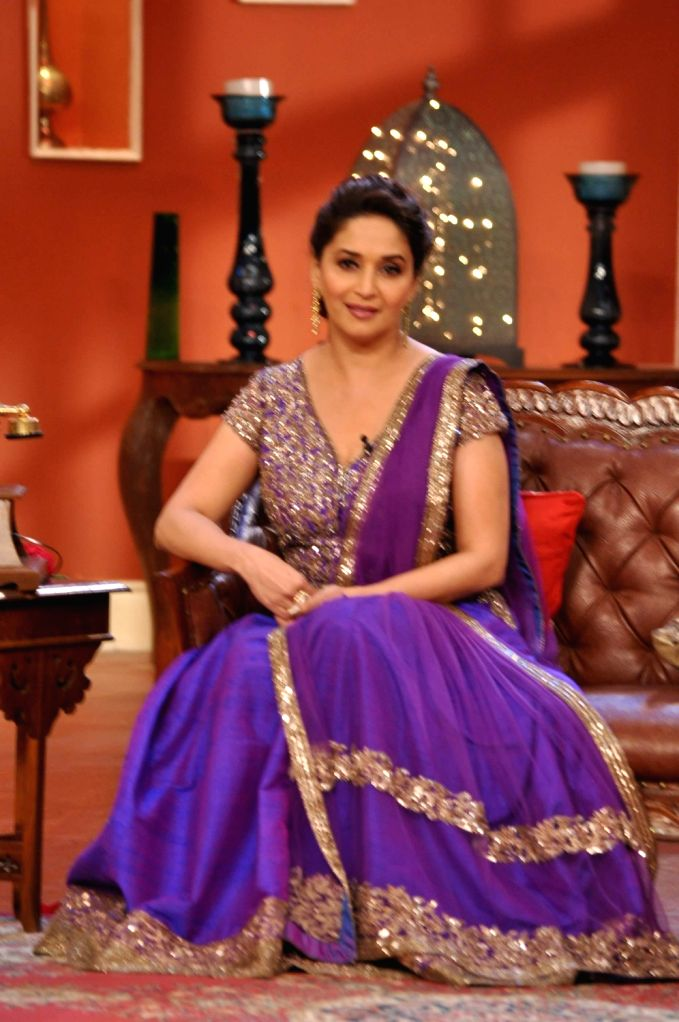 Actress Madhuri Dixit Nene on the sets of Comedy Nights with Kapil to promote her upcoming film Dedh Ishqiya in Mumbai on December 13, 2013. - Madhuri Dixit Nene