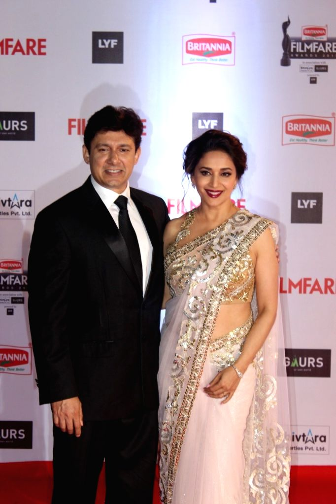Actress Madhuri Dixit Nene with her husband Dr Sriram Nene during the 61st Britannia Filmfare Awards in Mumbai on January 15, 2016. - Madhuri Dixit Nene