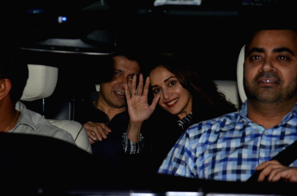 Actress Madhuri Dixit seen with her husband Sriram Madhav Nene at a restaurant in Mumbai's Bandra on March 1, 2019. - Madhuri Dixit