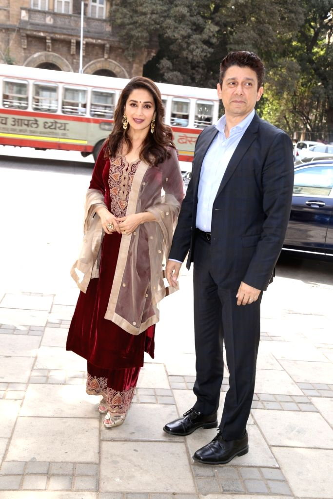 Actress Madhuri Dixit with her husband Sriram Madhav Nene arrives at Jehangir Art Gallery in Mumbai, on March 4, 2019. - Madhuri Dixit