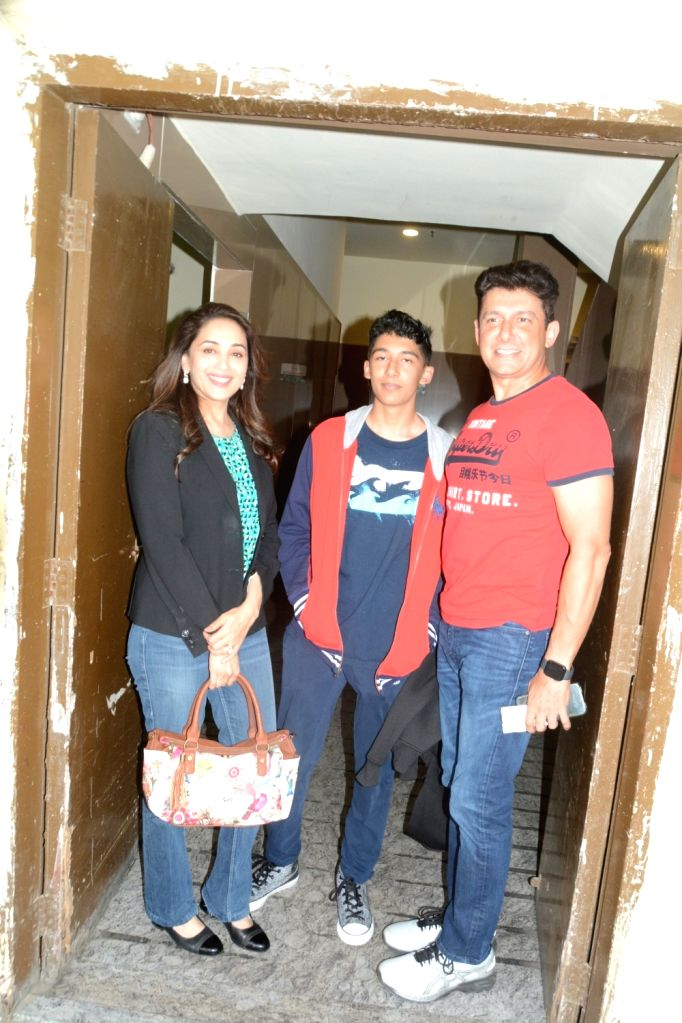 "Actress Madhuri Dixit with her husband Sriram Madhav Nene and son at the screening of the film ""Avengers: Endgame"" in Mumbai on April 27, 2019. - Madhuri Dixit"