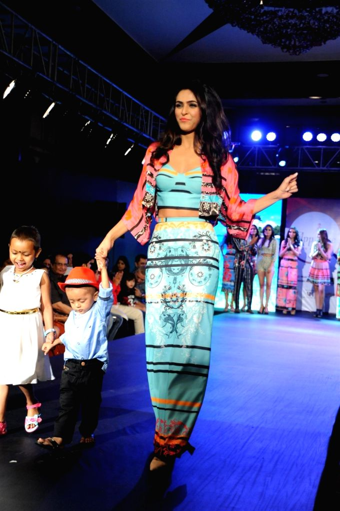 Actress Madhurima Tuli participate walk for Applause for Cause, a fund raising fashion show for an NGO called Access Life that caters to cancer treatments for children in Mumbai, on Nov 28, ... - Madhurima Tuli
