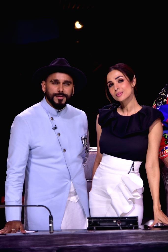 Actress Malaika Arora and Dance India Dance Season 7 judge and choreographer Bosco Martis, in Mumbai on July 18, 2019. - Malaika Arora