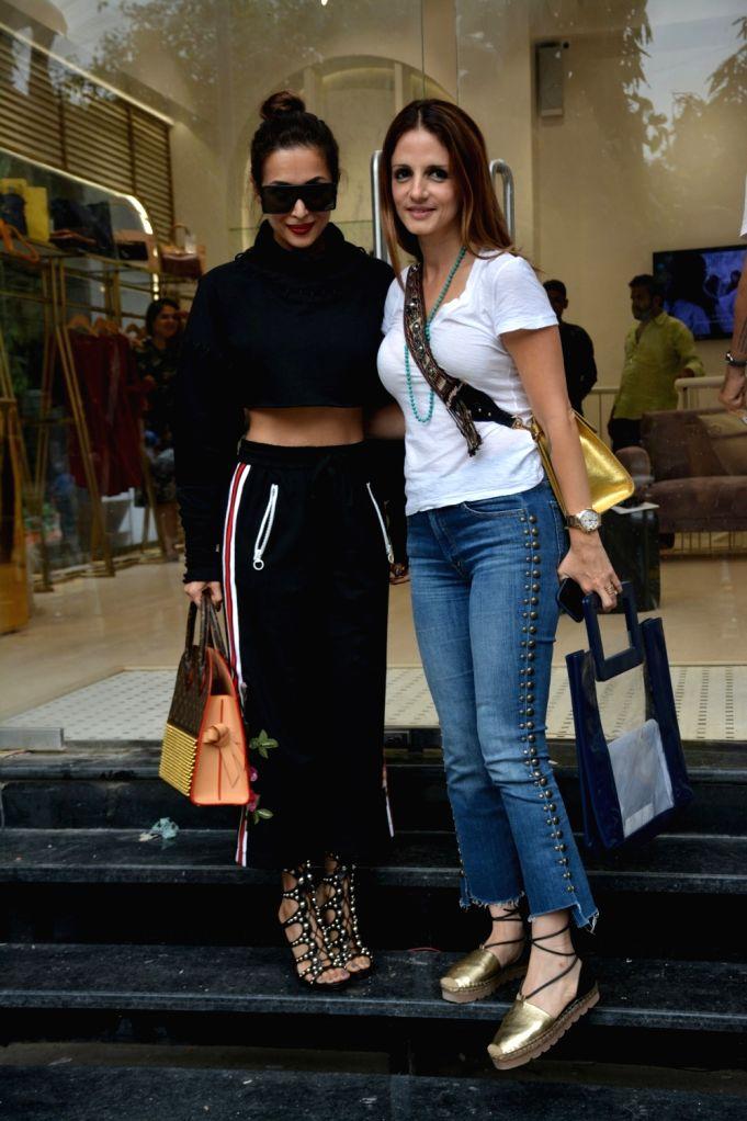 Actress Malaika Arora and interior designer Sussanne Khan seen at Mumbai's Bandra on July 31, 2018. - Malaika Arora and Sussanne Khan