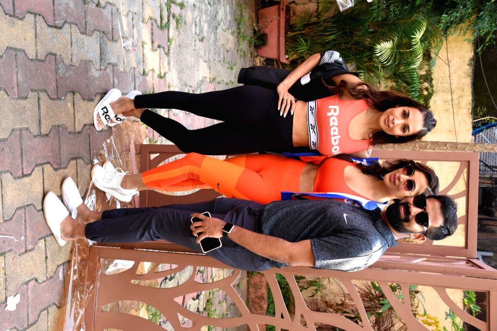 Actress Malaika Arora and singer Sophie Chowdhary seen at a yoga studio in Mumbai's Bandra on Oct 8, 2019. - Malaika Arora