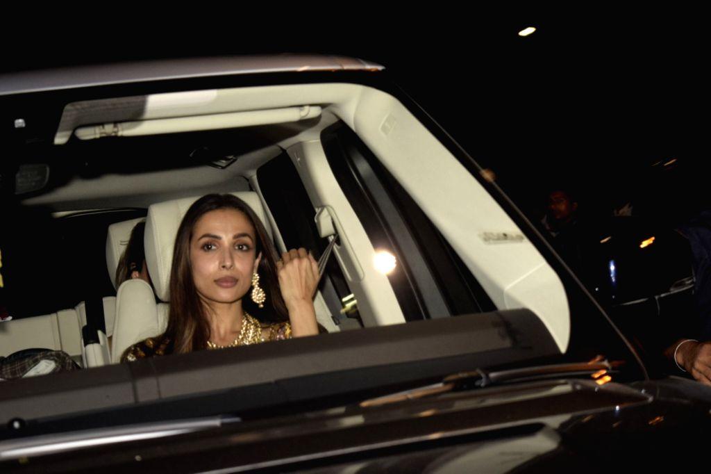 Actress Malaika Arora arrives for Diwali bash hosted by Shah Rukh Khan and Gauri Khan at their residence in Mumbai on Nov 4, 2018. - Malaika Arora and Rukh Khan