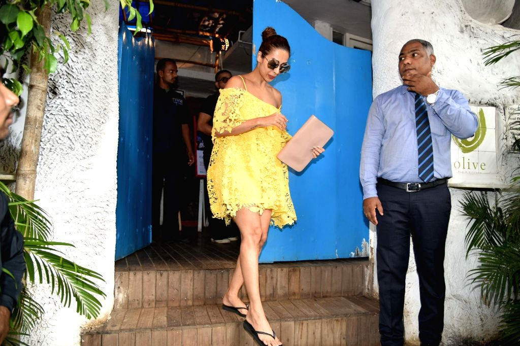 Actress Malaika Arora comes out after having diner with her ex husband Arbaaz Khan and his family in Mumbai on June 11, 2017. - Malaika Arora and Arbaaz Khan