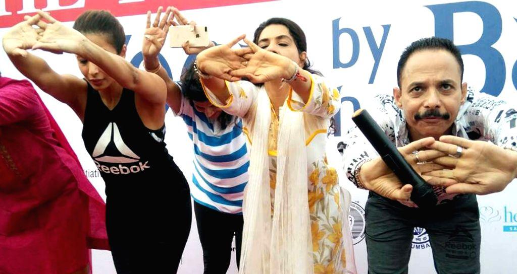 Actress Malaika Arora practices Yoga Asans  -postures- on International Yoga Day in Mumbai on June 21, 2017. - Malaika Arora