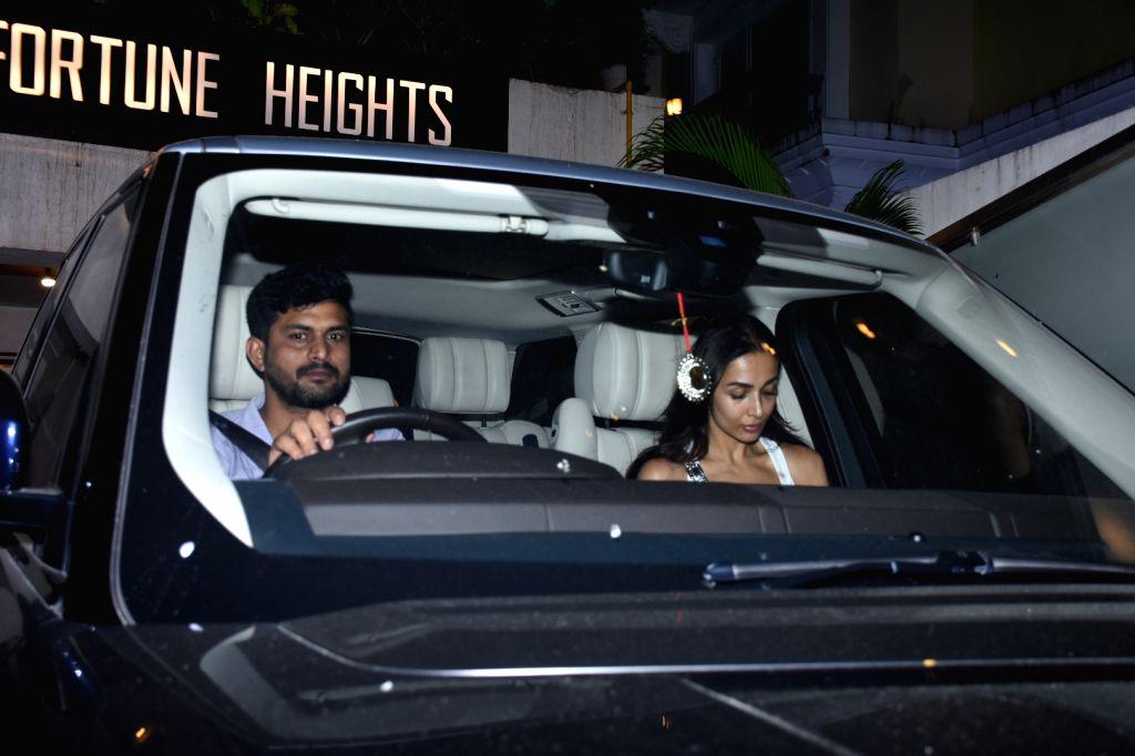 Actress Malaika Arora seen at the residence of actress Kareena Kapoor, in Mumbai on Oct 11, 2019. - Malaika Arora and Kareena Kapoor