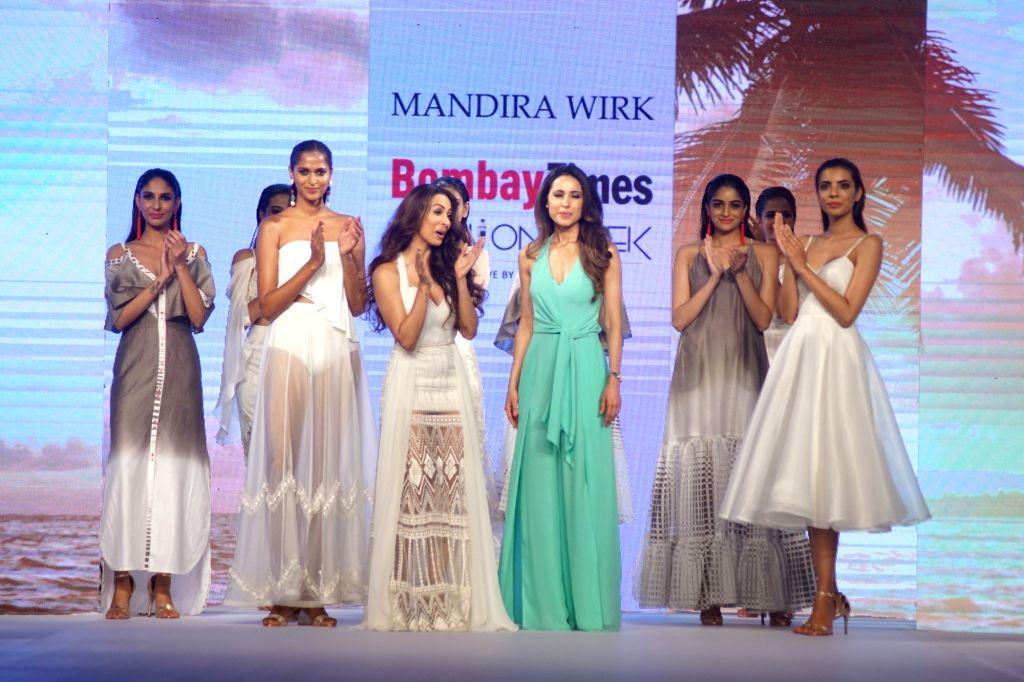 Actress Malaika Arora showcases creations of fashion designer Mandira Wirk at Bombay Times Fashion Week 2018 in New Delhi, on March 30, 2018. - Malaika Arora