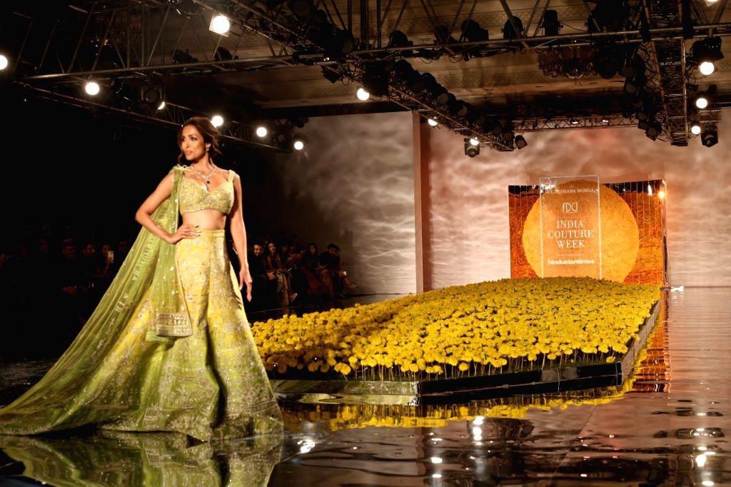 Actress Malaika Arora walks the ramp for designer Sulakshana Monga at India Couture Week 2019 in New Delhi, on July 25, 2019. - Malaika Arora