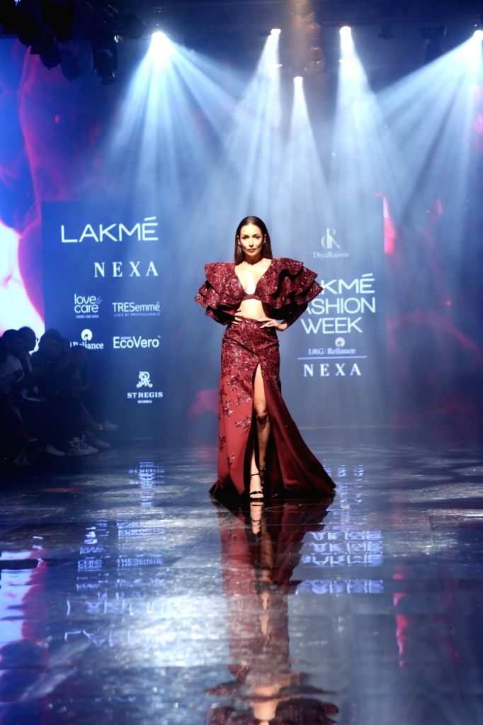 Actress Malaika Arora walks the ramp to showcase designer Diya Rajvir's creations at the Lakme Fashion Week Winter/Festive 2019 in Mumbai on Aug 25, 2019. - Malaika Arora