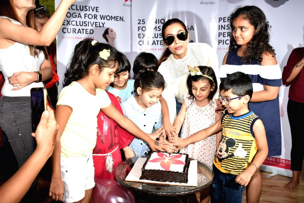 Actress Malaika Arora with children during a programme at her yoga studio in Mumbai, on March 9, 2019. - Malaika Arora
