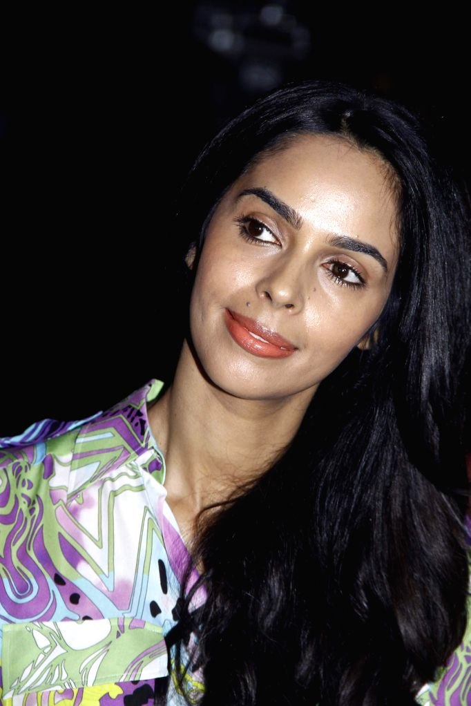 Actress Mallika Sherawat during the 25 years celebration of G.V Films and launch of its new website, in Mumbai on Aug 01, 2015. - Mallika Sherawat