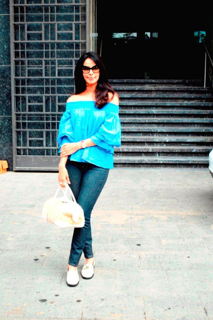 Actress Mallika Sherawat seen at Mumbai's Juhu on Aug 2, 2018. - Mallika Sherawat